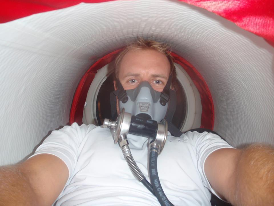 Diver in portable hyperbaric chamber